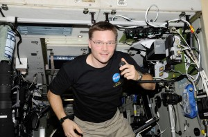 Doug Wheelock uses ham radio in the ISS service module.