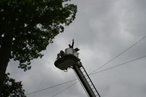 Mike WB3EQW waves to the crowd from the Hyde VFD bucket which assisted with antenna installation