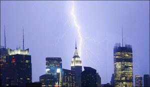 Lightning strikes the Empire State Building and other buildings causing debris to fall off during a severe thunderstorm in a sweltering NYC...Lightning strikes the Empire State Building and other buildings causing debris to fall off during a severe thunderstorm in a sweltering NYC  Ref: SPL34766  090608   Picture by: Jackson Lee / Splash News  Splash News and Pictures Los Angeles: 310-821-2666 New York: 212-619-2666 London: 870-934-2666 photodesk@splashnews.com
